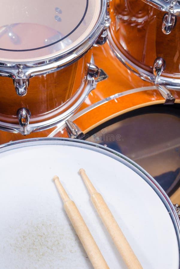 Drumsticks on drum close up stock photos