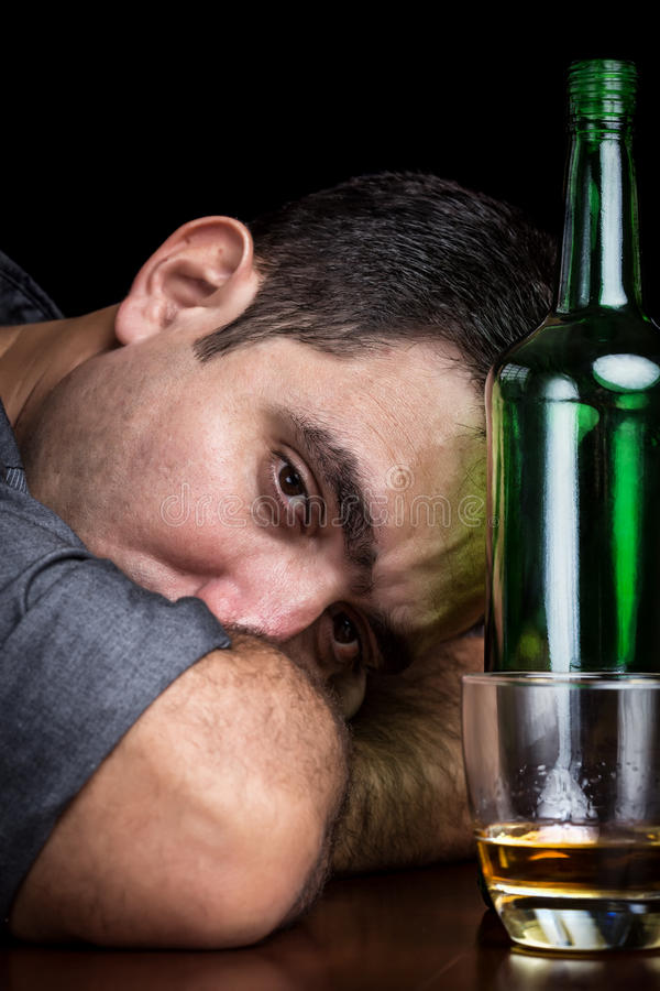 Free Drunk And Depressed Man Drinking Alone Royalty Free Stock Photos - 36624788