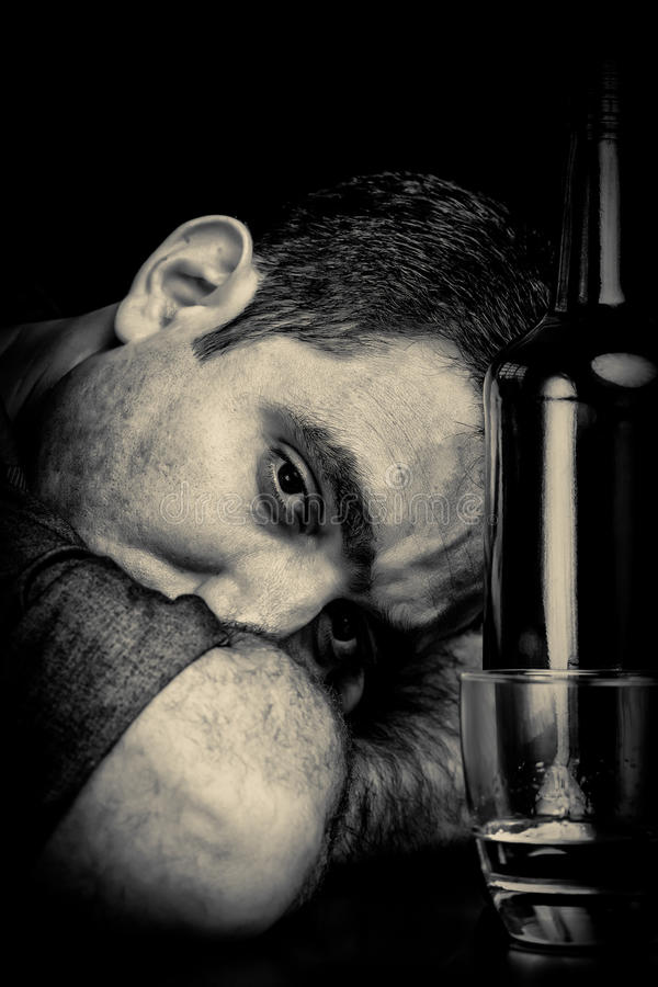 Free Drunk And Depressed Man Drinking Alone Royalty Free Stock Photos - 67599898