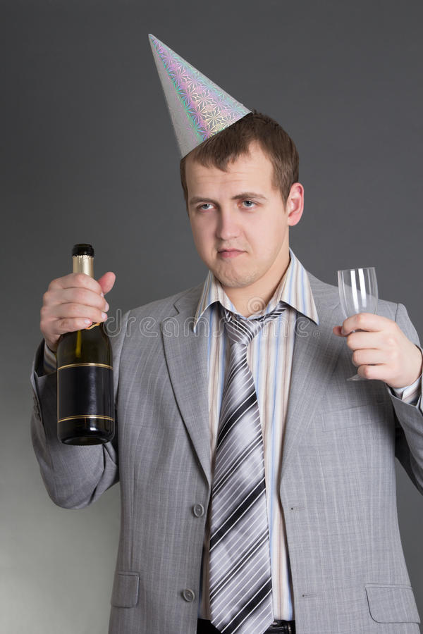 Drunk businessman at the birtday party. Over grey royalty free stock photos