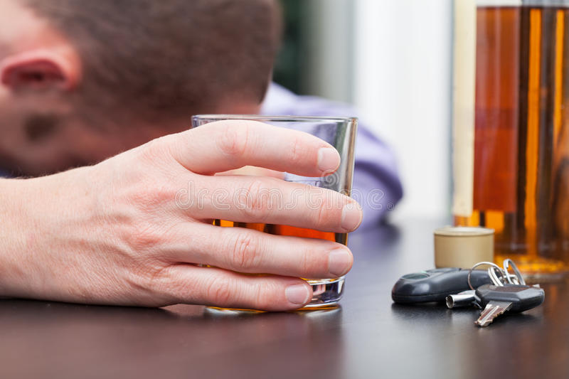Drunk driver sleeping on table royalty free stock images