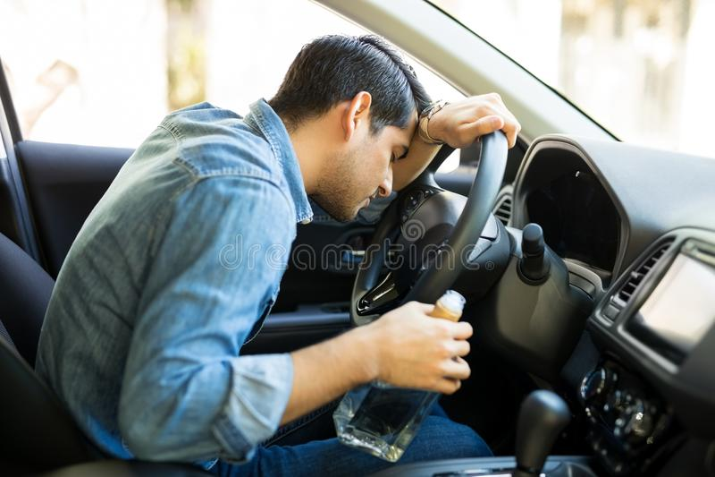 Drunk driver sleeps in car royalty free stock image