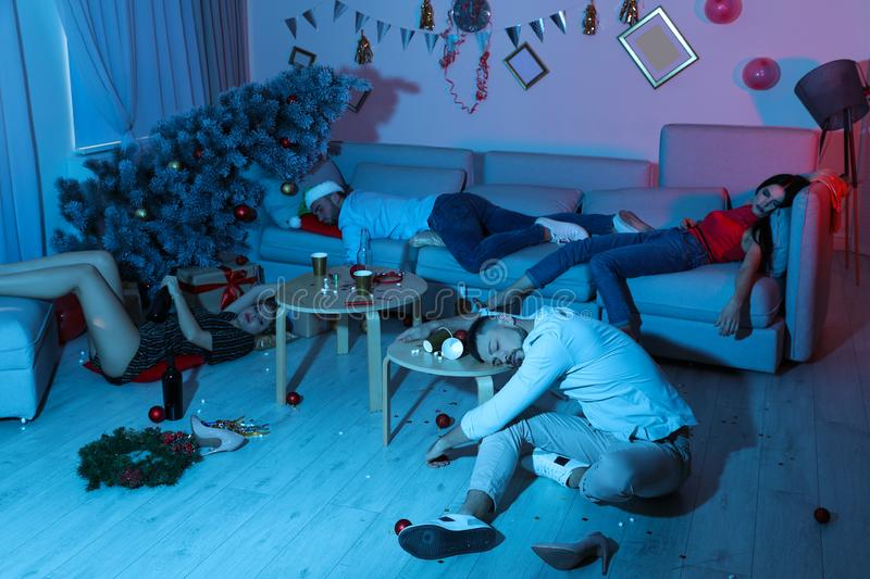 Drunk friends sleeping in messy room after New Year royalty free stock photo