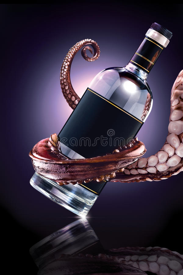 The drunk Ktulhu. The photo of tentacle holding the bottle royalty free stock photo