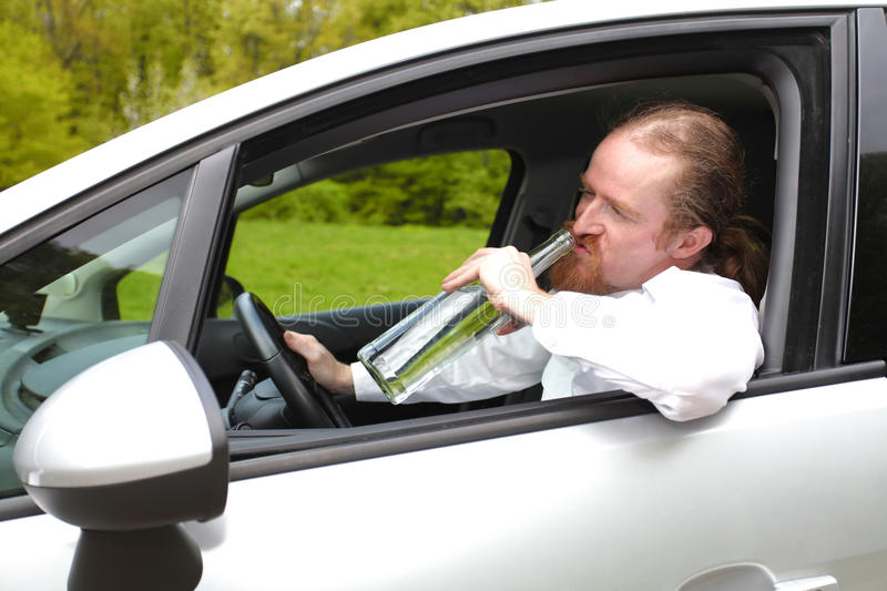 Drunk man in car royalty free stock photography