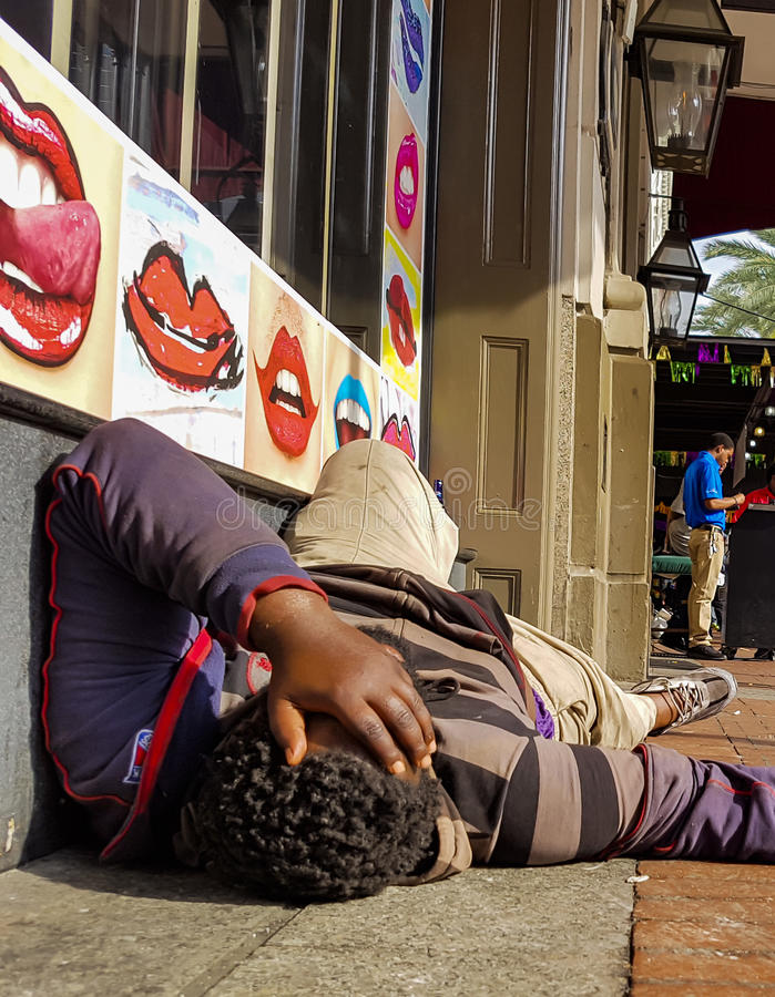 Drunk man after Mardi Gras in New Orleans royalty free stock image