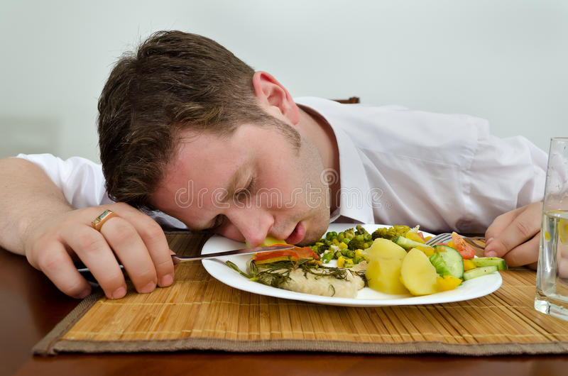 Drunk man sleeping stock image