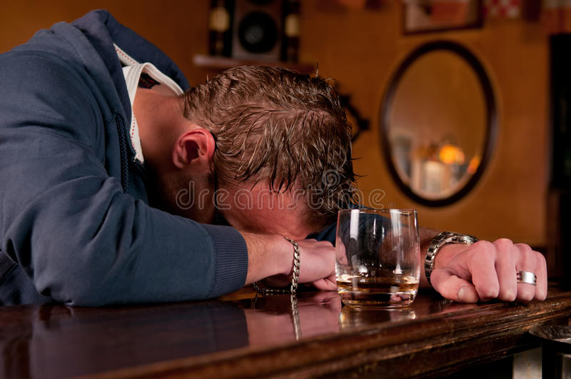 Drunk man who has had one too many at the bar royalty free stock images