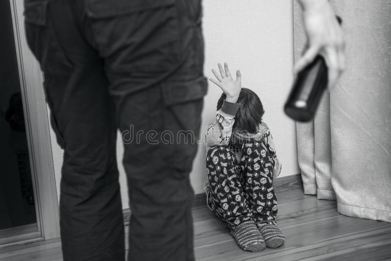 Drunk parent and little scared son. Violence against children concept. Aggression in the family. Alcohol abuse. Domestic violence royalty free stock images