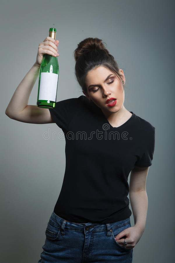 Drunk Woman Holding Wine Bottle. stock photography