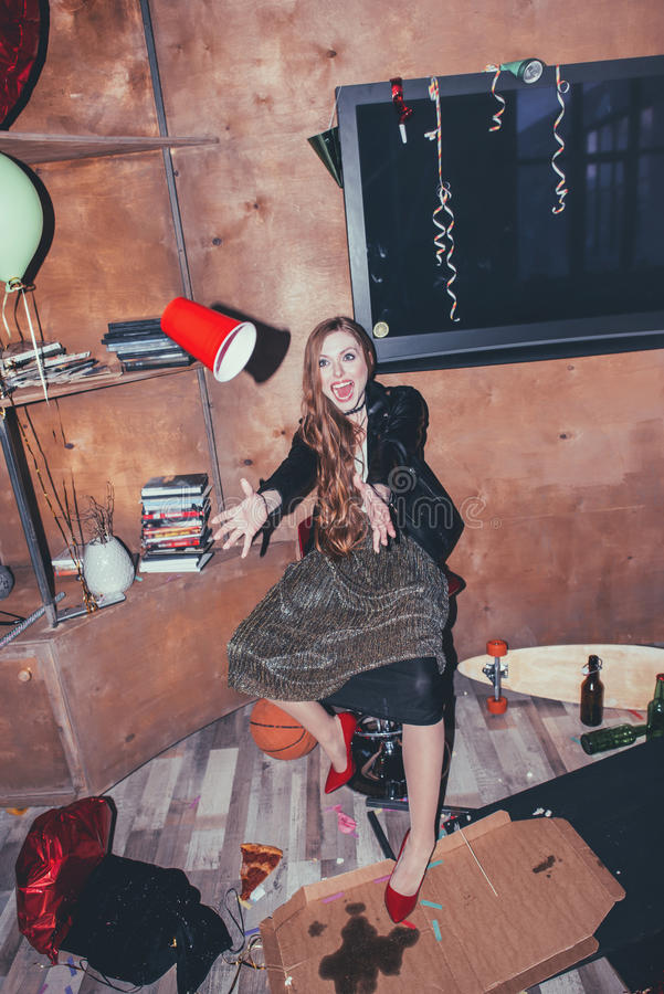 Drunk woman in messy room after party royalty free stock image