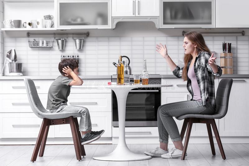 Drunk woman yelling at her son royalty free stock photo