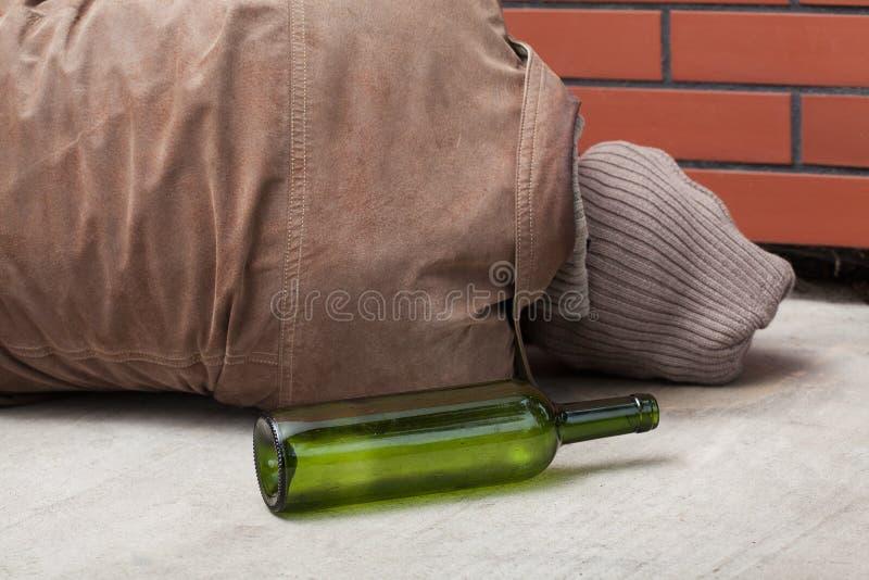 Drunkard and bottle stock photo