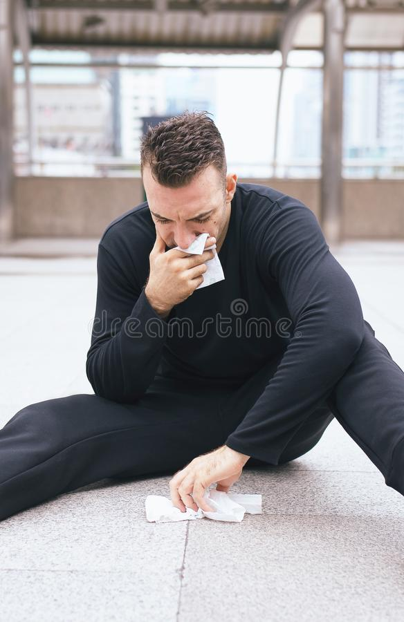 Drunken man sitting on street after drinking alcohol hangover in party at night royalty free stock images