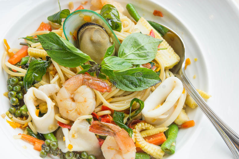 The drunken noodles seafood spaghetti. Food taste of Thailand stock photo