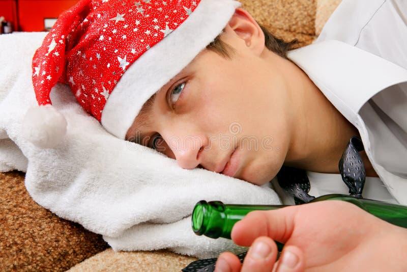 Drunken Teenager in Santa Hat royalty free stock photo