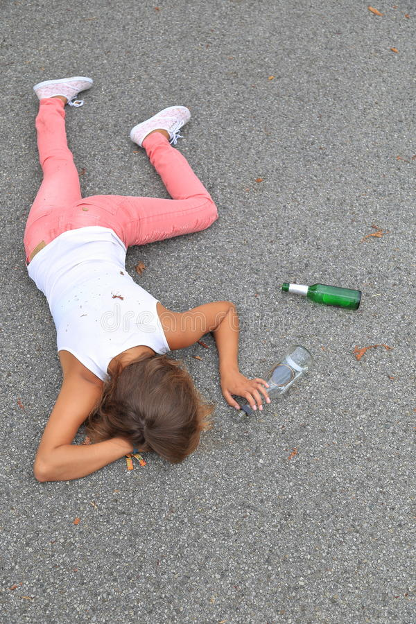 Drunken young women lying on the street royalty free stock image