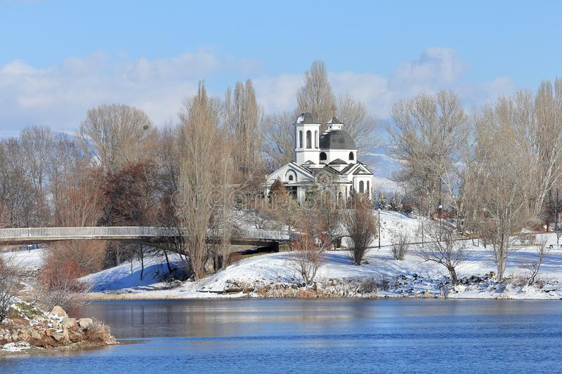 St. Naum Ohridski Church in the winter. Druzba Lake Park is situated in Sofia City, capital of Bulgaria. The lake is with shape of 8. The park features 2