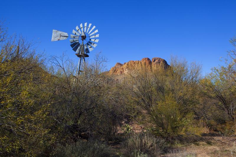 The dry, Arizona desert located in the southwest United States on a cloudless day. A windmill surrounded by the dry, Arizona desert located in the southwest stock images