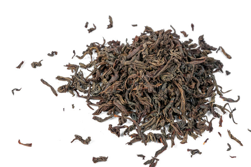 Dry black tea leaves isolated on white background. Dry black tea stock photography