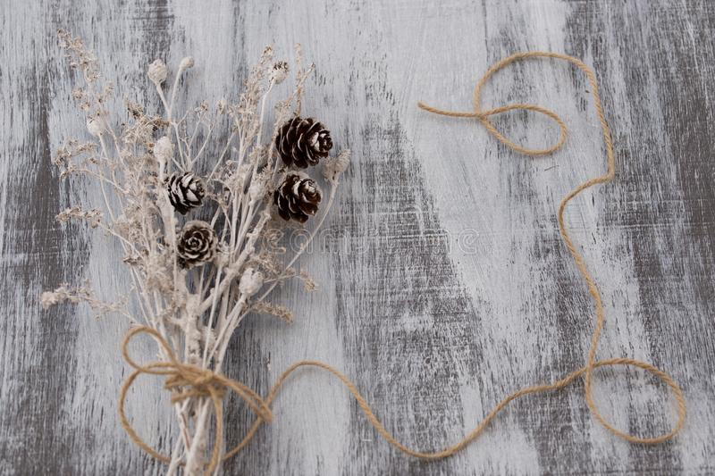 Dry bouquet on wooden background royalty free stock image