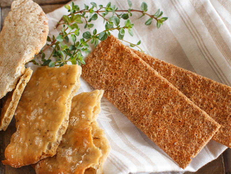 Dry bread with herbs on napkin and wooden tray royalty free stock photo