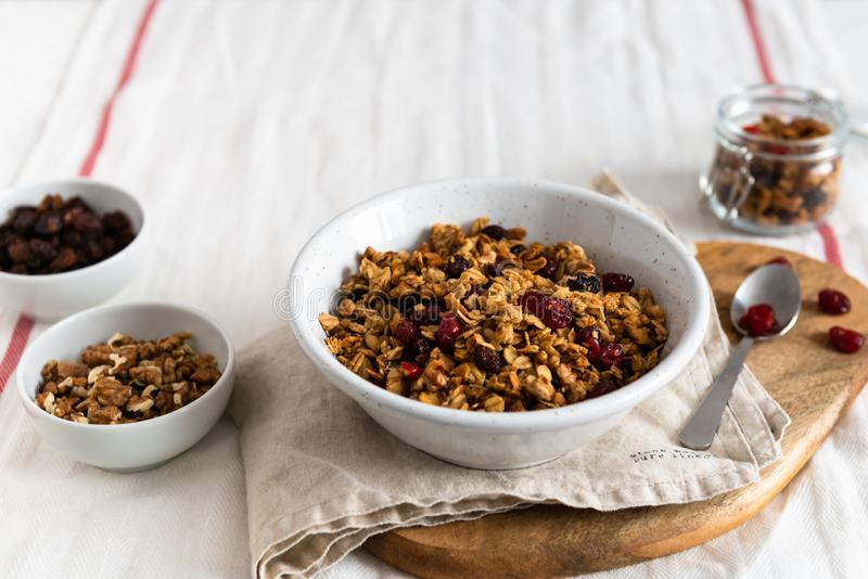 Dry breakfast cereals. Crunchy honey granola bowl with flax seeds, cranberries and coconut. Healthy, vegeterian fiber food. royalty free stock photos