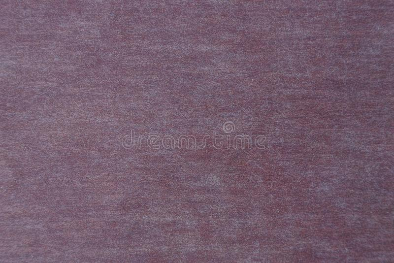 Dry brown texture from the cover of the book stock image