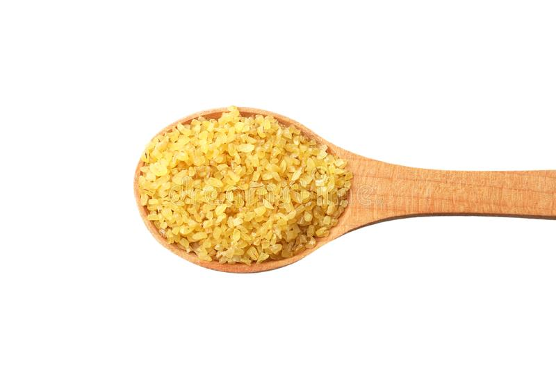 Dry bulgur wheat in wooden spoon isolated on white background. top view royalty free stock photo