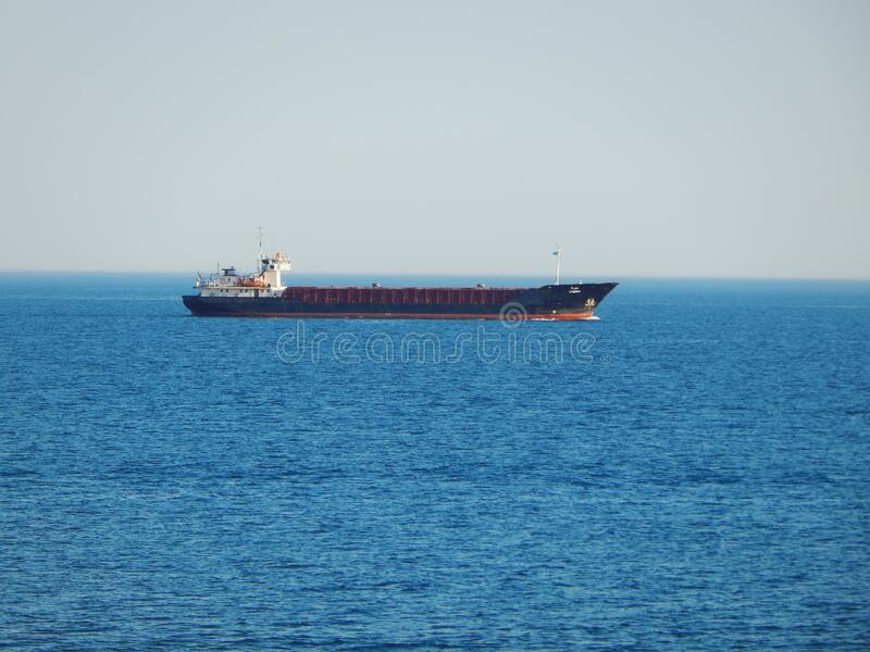 Dry cargo ship in the Caspian Sea. Ship departed from the port of Aktau. Kazakhstan. Caspian Sea. Kazakhstan. Mangistau region. 11 July 2019 year royalty free stock photo