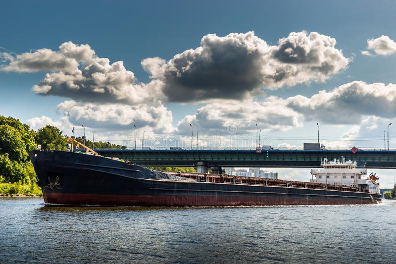 Dry cargo ship on the Moscow Canal river in summer day royalty free stock photo