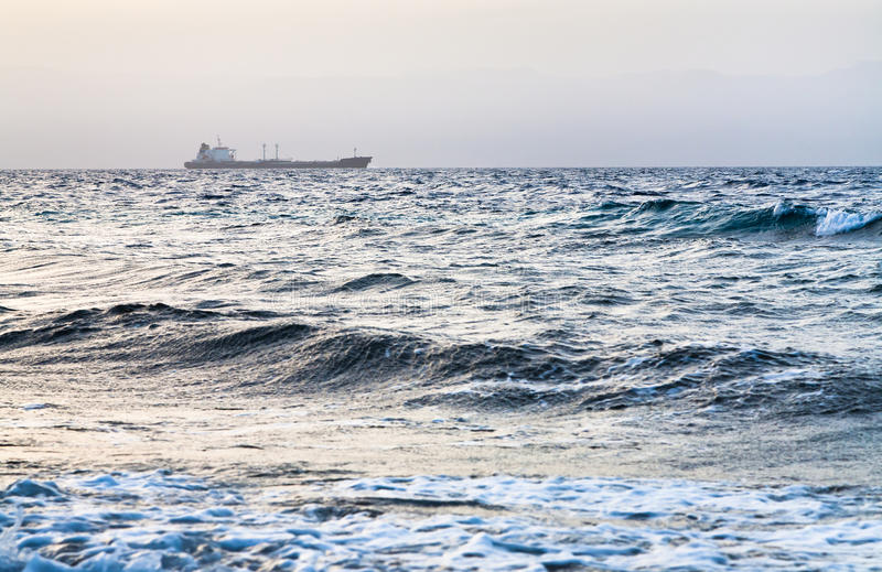 Download Dry Cargo Ship In Red Sea On Blue Sunset Royalty Free Stock Images - Image: 24521109