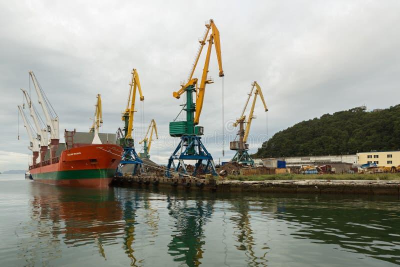Dry cargo ship Vladimir Myasnikov and port cranes in the Avacha Bay. stock images