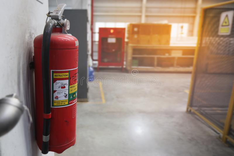 Dry chemical fire extinguisher were mounted on the walls of  working area royalty free stock photography