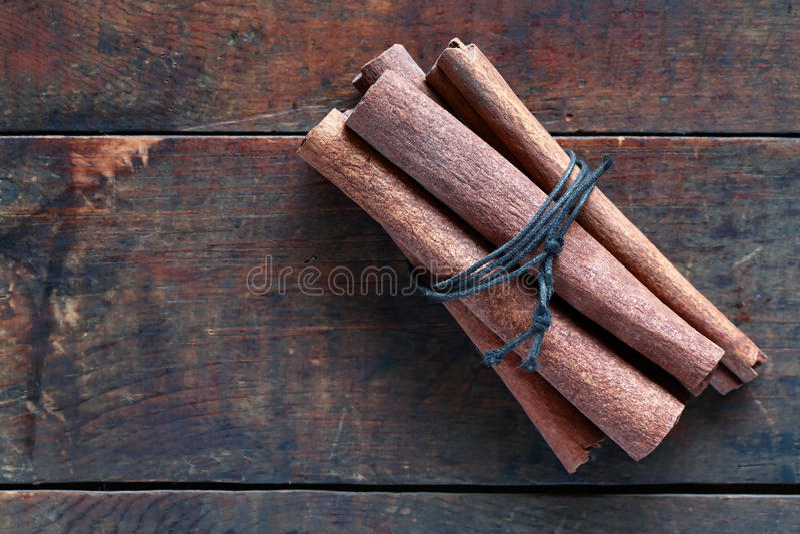 Dry Cinnamon On Wood royalty free stock photo