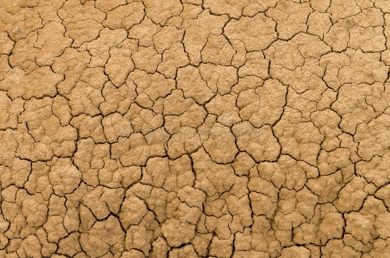 Dry clay soil. Clay sandy earth parched and cracked stock images