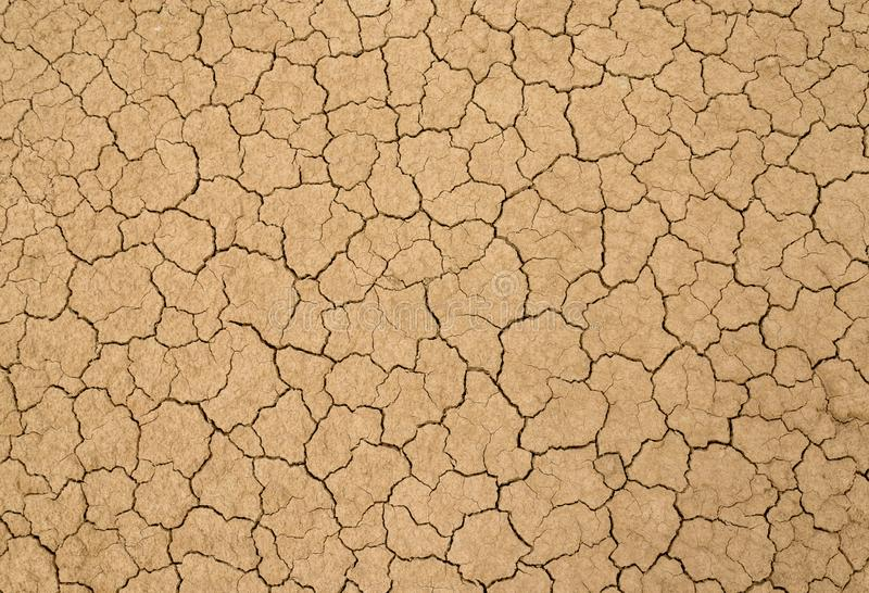 Dry clay soil. Clay sandy earth parched and cracked royalty free stock image