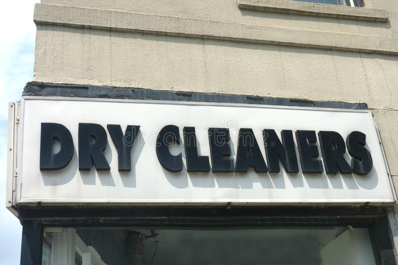 Dry Cleaners. A dry cleaners sign at a storefront stock photo