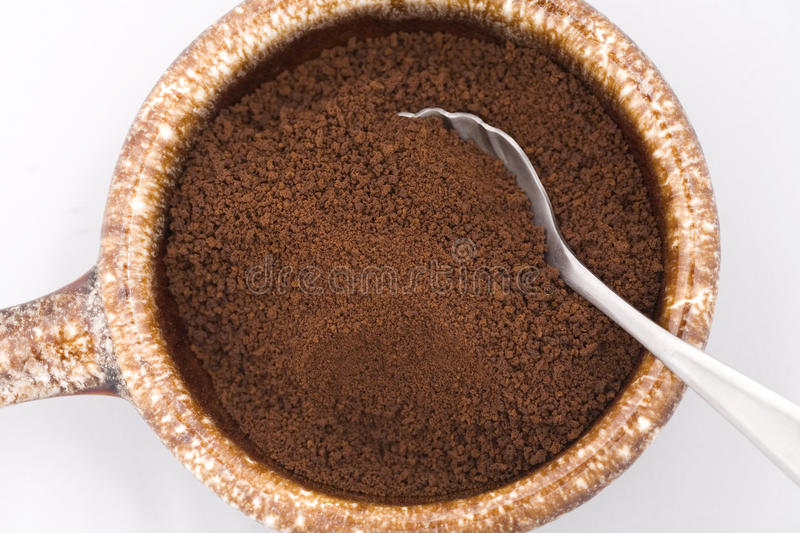 Dry coffee grounds in a bowl. royalty free stock image