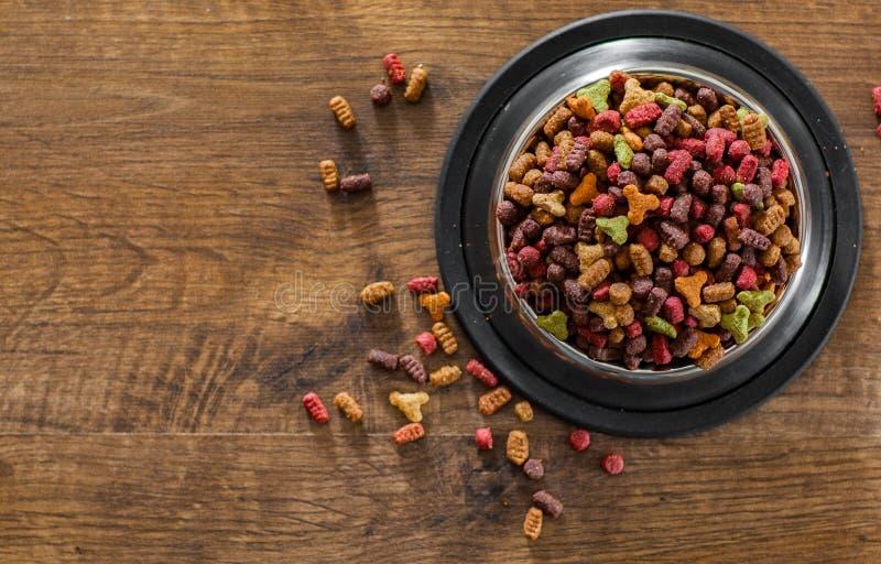 Dry Colorful cat food in metal bowl stock image