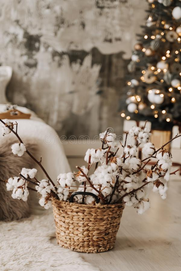 Dry Cotton Branches in Wicked Basket Decoration stock image