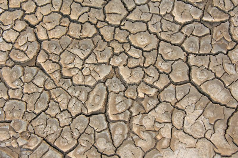 Dry cracked earth background. Cracked mud pattern. Soil In crack. Barren earth. Dry cracked earth background. Cracked mud pattern. Soil In cracks.Creviced royalty free stock photography