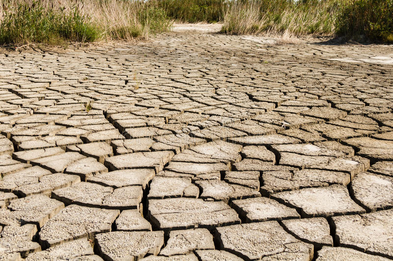 Dry Cracked Earth. Dry cracked sand flats during drought stock photos