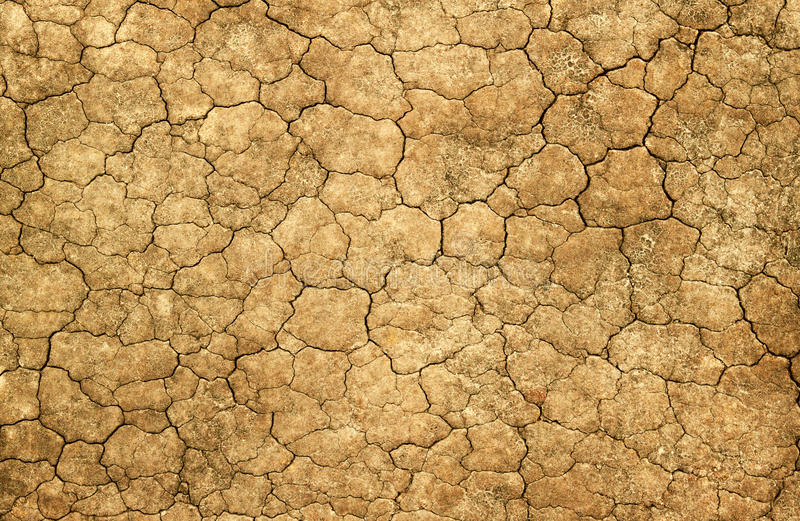 Dry cracked mud natural abstract background. stock image