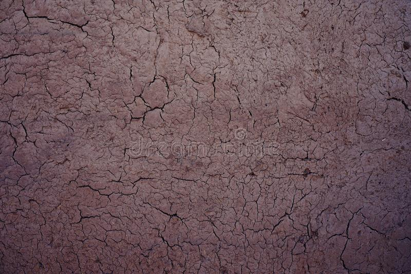 Dry cracking mud wall texture, natural background concept royalty free stock images