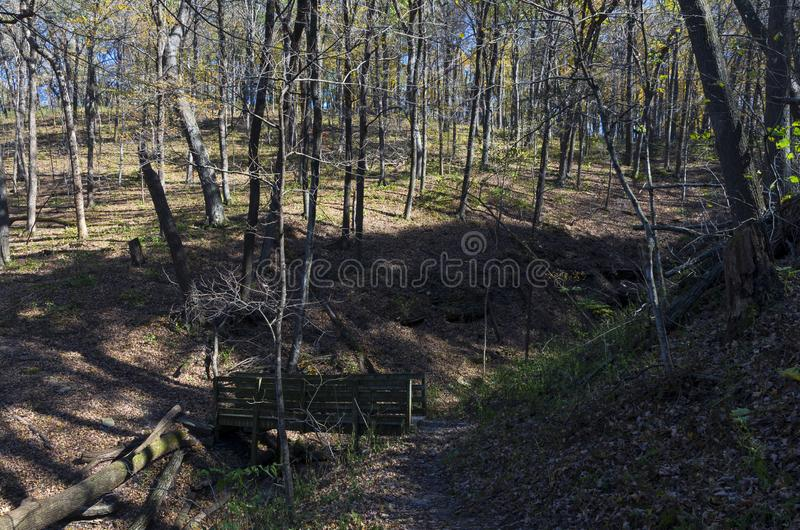 Dry Creek and Bridge in Wyalusing. Dry creek bed and bridge ravine along wooded trail in wyalusing state park wisconsin royalty free stock photo