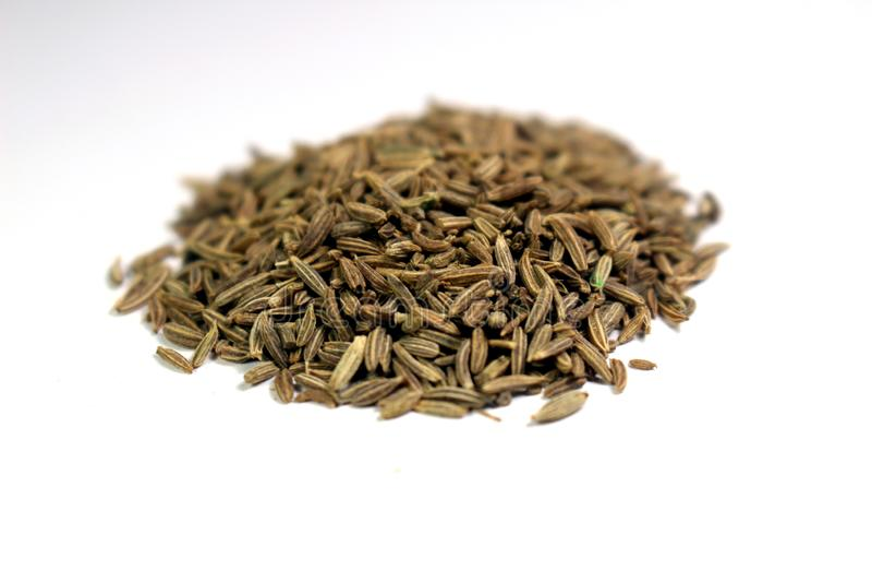 Dry Cumin zeera seeds isolated on white background stock photos
