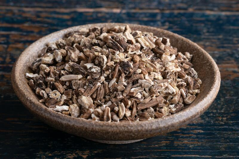 Dry Dandelion Root in a Bowl. Close up view of dry dandelion root in a bowl stock photo