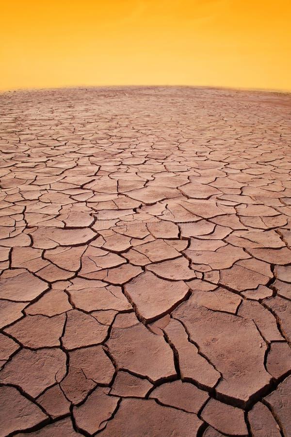 Dry desert. Dry and cracked desert under sky stock images