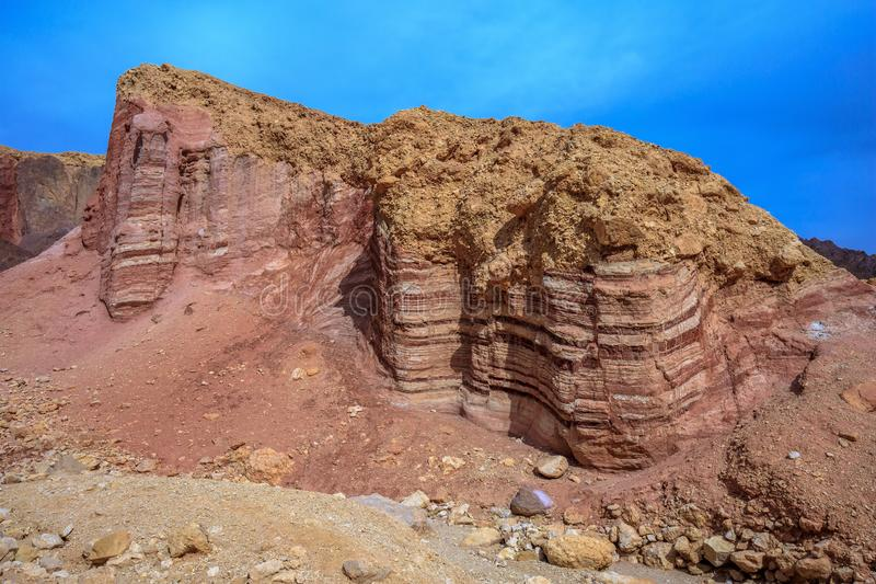 Dry desert near Eilat, Israel. Dry stone desert near the southern seaside resort of Eilat, Israel. Pink sandstone buttes of bizarre shapes royalty free stock photos